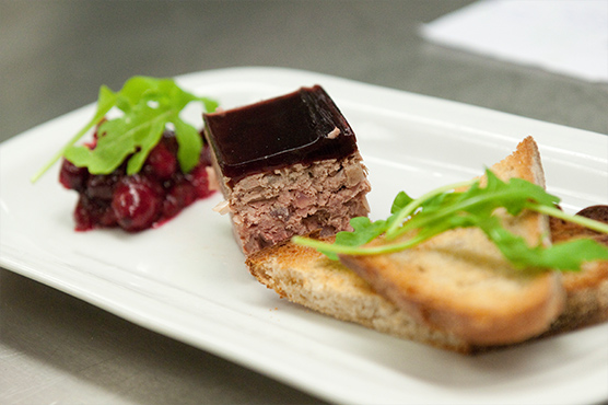 Try our mouth-watering game terrine with port jelly glaze, cranberry compote and artisan toast